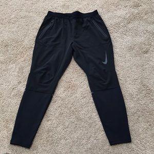 Nike medium black athletic full length tights.